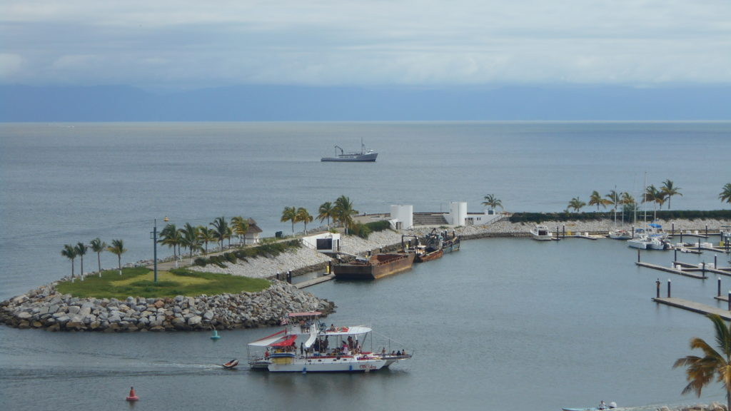 Chica Locca Tours coming into La Cruz Marina from the balcony view of Nayri Penthouse